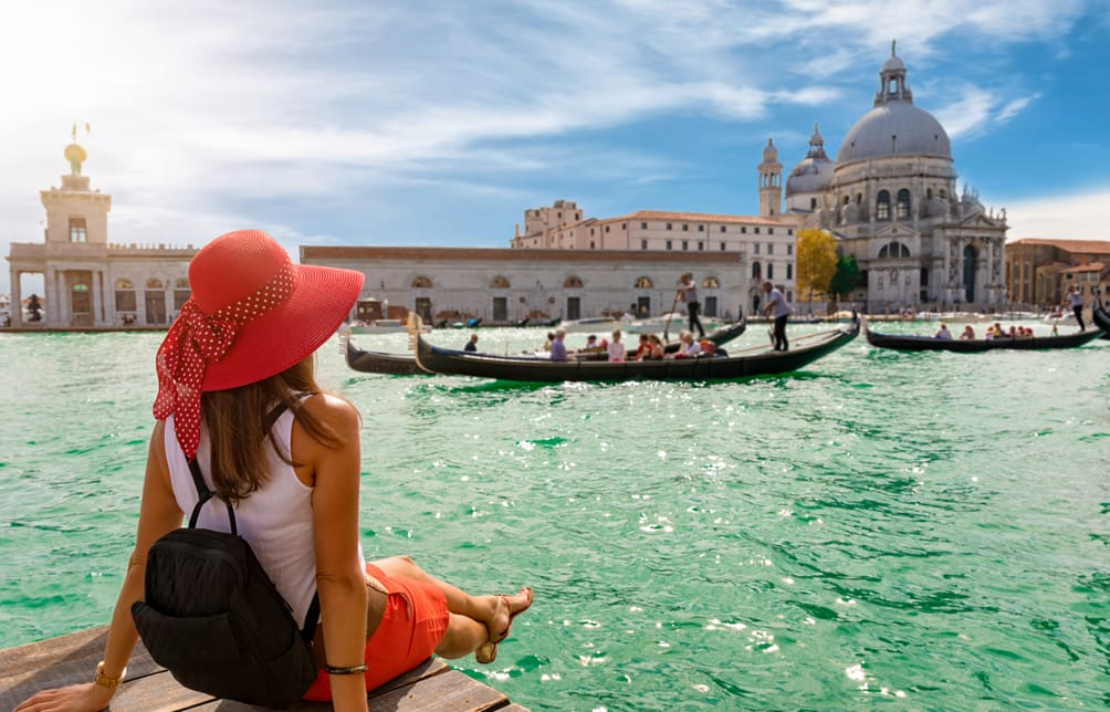Woman looking across the water at Venice