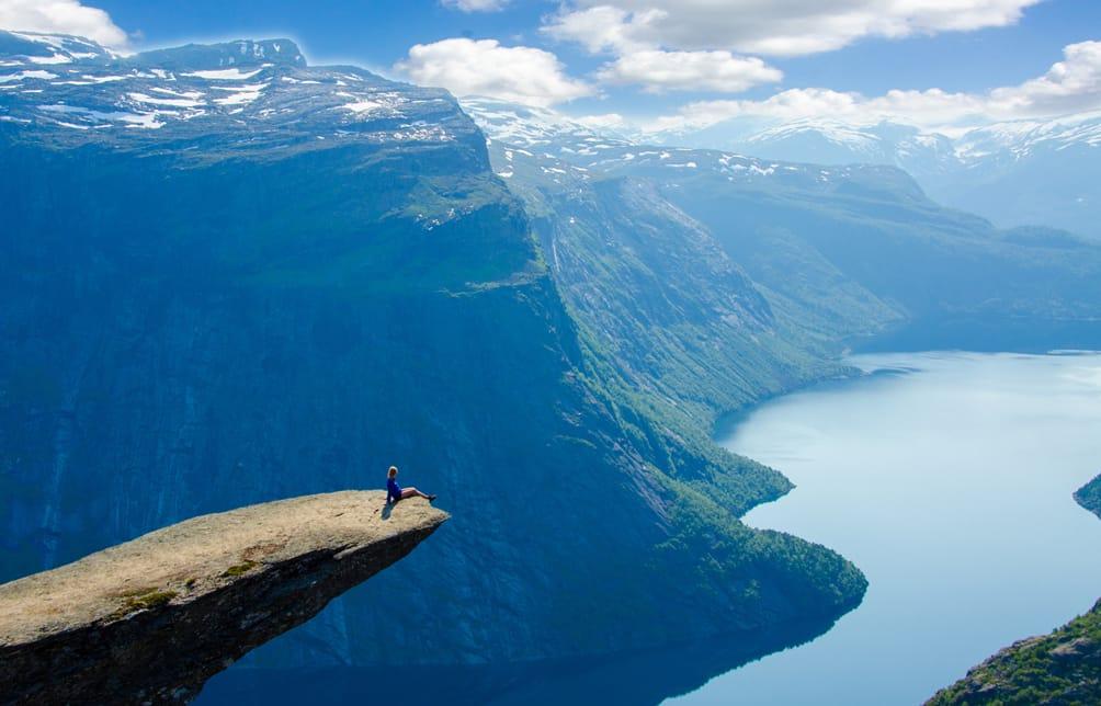 Woman on rock overlooking mountains